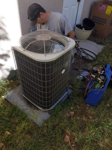 Greg servicing an air conditioner