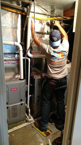 Employee repairing a furnace